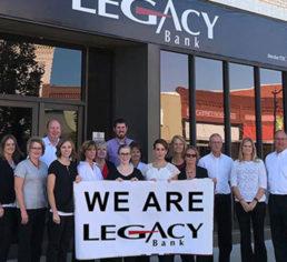 Legacy bank employee holding