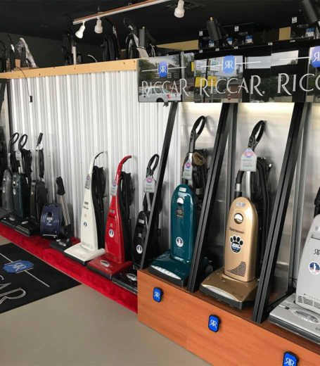 row of vacuum cleaners