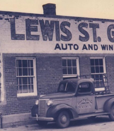 antique truck in front of lewis st. glass brick building