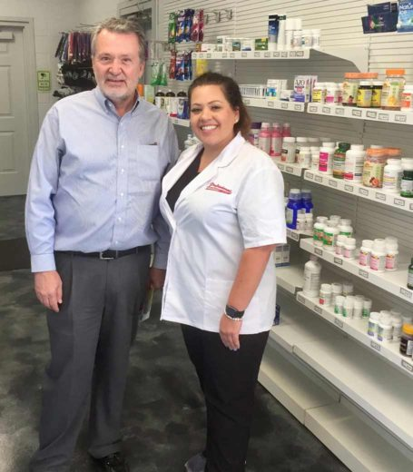 man and woman standing in pharmacy