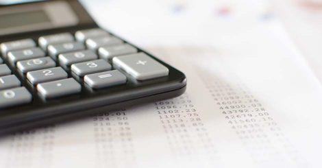 calculator sitting on printed spreadsheet