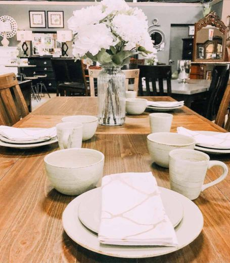 table set with white flowers and dining ware