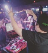 DJ performing for a crowd in a club