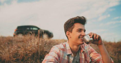 Smiling Handsome Teenage Boy Drinking Tea